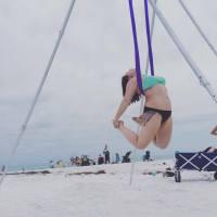 aerial yoga beach open chest