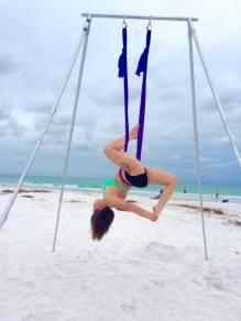 aerial yoga on beach invert graceful