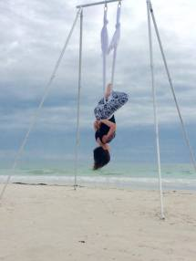 aerial yoga on beach invert